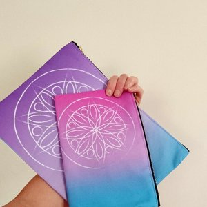 mandala illustration design printed on red bubble studio pouches