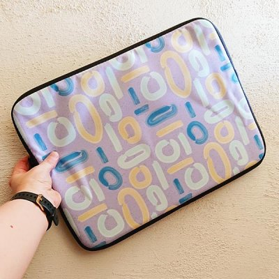 abstract lilac surface pattern on laptop sleeve